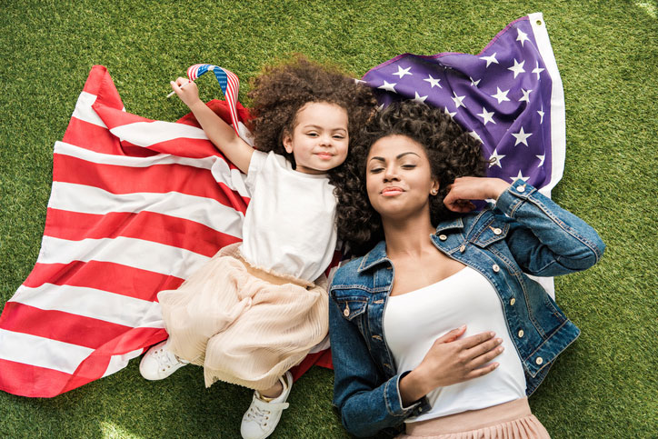 mother daugther in american flag